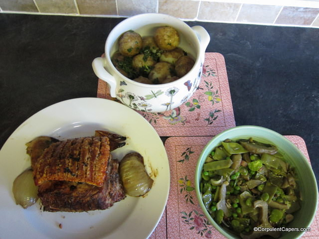 Roast Pork, Steamed Potatoes and garden vegetables.