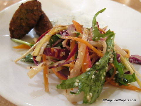 Picture of squash falafel with a rainbow carrot salad