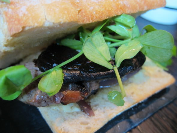 Seared Welsh sirloin steak with caramelised red onions & garlic mushrooms on toasted ciabatta