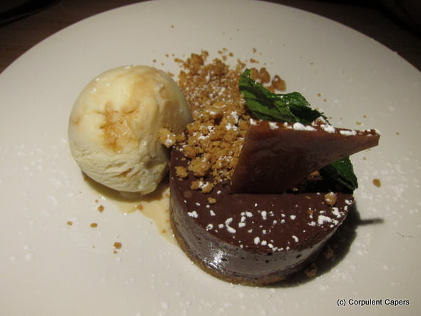 Chocolate mousse on peanut biscuit base with praline and a dollop of ice-cream